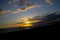 Family walk on Medano beach at sunset Tenerife - Jess Hurd - ,2010s,2012,beach,beaches,Canary,cloud,clouds,coast,coastal,coasts,country,countryside,eni environmental issues,eu,european,europeans,eurozone,families,Family,holiday,holiday maker,holiday makers,holi