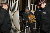 Occupy London protesters leave a derelict branch of the Iraqi Rafidain Bank in the main financial district London after being informed by police that commercial attache building actually had foreign c... - Jess Hurd - 27-01-2012