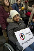 Disabled activists and UK Uncut protest oppose the Welfare Reform Bill. Disabled protesters chain themselves together at Oxford Circus. London. - Jess Hurd - 28-01-2012