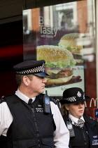 Policing a Right to Work protest against Workfare, the new unemployment scheme, McDonalds restaurant. Oxford Street, London. - Jess Hurd - 25-02-2012