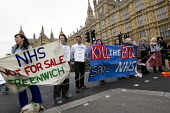 UK Uncut protesters who blocked the road outside the House of Lords against the NHS Bill. Westminster, London. - Jess Hurd - 27-02-2012