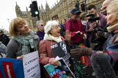 Tory woman argueing with 81 year old Shirley Murgraff an UK Uncut protesters who blocked the road outside the House of Lords against the NHS Bill. Westminster, London. - Jess Hurd - 27-02-2012