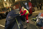 Council workers clear away tents. Occupy LSX eviction, St. Pauls Cathedral. London. - Jess Hurd - 28-02-2012