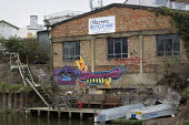 On the canal round the Olympic construction site, East London. - Jess Hurd - 2010s,2012,canal,canals,cities,city,derelict,DERELICTION,towpath,urban