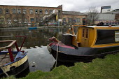 On the canal round the Olympic construction site, East London. - Jess Hurd - 2010s,2012,boat,boats,canal,canals,cities,city,derelict,DERELICTION,disused,hobbies,hobby,hobbyist,Leisure,LFL,LIFE,narrowboat,narrowboats,PEOPLE,RECREATION,RECREATIONAL,urban,vessel,vessels,warehouse