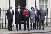 The Chancellor, George Osborne leaves, with his treasury team pose before leaving 11 Downing Street to deliver his Budget to Parliament. Westminster, London. (L to R) Mark Hoban, Danny Alexander, Chlo... - Jess Hurd - 21-03-2012