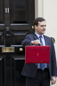 The Chancellor, George Osborne leaves 11 Downing Street to deliver his Budget to Parliament. Westminster, London. - Jess Hurd - 2010s,2012,Budget Box,ConDems Coalition,CONSERVATIVE,Conservative Party,conservatives,deliver,leaves,London,Ministerial Box,POL,political,POLITICIAN,POLITICIANS,Politics,Street,Westminster