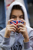 Young man on a union jack iphone, Piccadilly Circus, London. - Jess Hurd - 29-03-2012