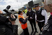 G4S Olympic security guards call the police to try to prevent photographers and video journalists from filming the Olympic site from the public highway. Stratford, East London. - Jess Hurd - 21-04-2012