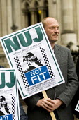 Video journalist Jason N. Parkinson with NUJ and PCS supporters outside the Royal Courts of Justice before the Dale Farm production order judicial review. The High Court appeal is challenging a previo... - Jess Hurd - 25-04-2012