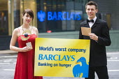 World Development Movement campaigners stage an award ceremony outside Barclays Bank HQ in Canary Wharf handing over a �shame award � won by the bank ahead of its AGM on 27 April. Two glamorous hosts... - Jess Hurd - 2010s,2012,activist,activists,Bank,BANKS,CAMPAIGN,campaigner,campaigners,CAMPAIGNING,CAMPAIGNS,ceremonies,ceremony,company,DEMONSTRATING,Demonstration,DEMONSTRATIONS,Development,evening,food,FOODS,Mov
