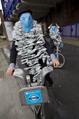 Campaigners from the World Development Movement protest at Barclays AGM, exposing Barclays Capitals role in food speculation which WDM say increases global food prices leaving millions facing hunger a... - Jess Hurd - 27-04-2012