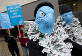 Campaigners from the World Development Movement protest at Barclays AGM, exposing Barclays Capitals role in food speculation which WDM say increases global food prices leaving millions facing hunger a... - Jess Hurd - 2010s,2012,activist,activists,against,anti,bank,banker,bankers,banking,banks,bike,bikes,businessman,businessmen,CAMPAIGN,campaigner,Campaigners,CAMPAIGNING,CAMPAIGNS,capital,capitalism,capitalist,Comm
