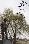 Black balloons representing those killed at work are released at the Statue of the Unknown Building Worker. Health and Safety Day of Action. Workers International Memorial Day. London. - Jess Hurd - 28-04-2012