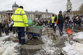 Heritage Wardens and Westminster City Council workers clean up after a Flash mob pillow fight in Trafalgar Square. International Pillow Fight Day, London. - Jess Hurd - 07-04-2012