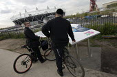 Hasidic Jews view the Olympic stadium, Olympic Park, Stratford. East London. - Jess Hurd - 16-04-2012