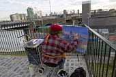Ruth a local landscape painter paints the view of Canary Wharf from the Olympic Park, Stratford. East London. - Jess Hurd - 2010s,2012,ACE,art,artist,artists,arts,cities,city,cityscape,cityscapes,culture,easel,hobbies,hobby,hobbyist,landscape,landscapes,Leisure,LFL,LIFE,local,modern,modernism,modernist,modernists,Olympic S
