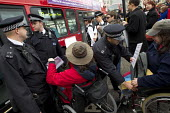 Disabled activists demonstrate and block Trafalgar Square against benefit cuts and the Welfare Reform Bill. London. - Jess Hurd - 18-04-2012