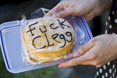 Fuck Clegg Victoria Sponge cake. UK Uncut Great London Street Party outside Nick Clegg MPs London home. Putney. - Jess Hurd - 2010s,2012,activist,activists,against,anti,austerity,Austerity Cuts,cake,cakes,CAMPAIGN,campaigner,campaigners,CAMPAIGNING,CAMPAIGNS,civil disobedience,confectionery,cuts,DEMONSTRATING,Demonstration,D