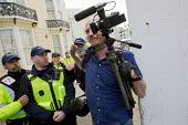 Video journalist Jason N. Parkinson (showing his NUJ press card), is pushed through a cordon after being assaulted by an EDL supporter and a police officer from Essex police. English Defence League di... - Jess Hurd - 02-06-2012