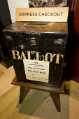 Old council election ballot box used as the express checkout at the luxurious Town Hall Hotel, Hackney, East London. - Jess Hurd - 2010s,2012,Ballot Box,box,boxes,campaign,campaigning,CAMPAIGNS,cities,city,council,developer,developers,development,EBF,Economic,Economy,Hackney,hotel,hotels,local authority,redevelopment,regeneration