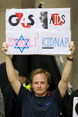 Protesters demonstrate outside the private security company G4S Annual General Meeting calling for an end to the firms' involvement in human rights abuses around the world including Israeli prisons. L... - Jess Hurd - 2010s,2012,activist,activists,against,AGM,CAMPAIGN,campaigner,campaigners,CAMPAIGNING,CAMPAIGNS,company,corporate,DEMONSTRATING,demonstration,DEMONSTRATIONS,deportation,deporting,detained,detainee,det