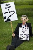 Protester with a Tony Blair mask demanding he be taken to The Hague for war crimes. March against MOD plans to site surface-to-air missiles on roofs for security during the Olympics, Bow, Tower Hamlet... - Jess Hurd - 30-06-2012
