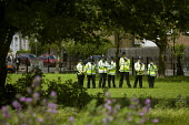 police officers in the park. March against MOD plans to site surface-to-air missiles on roofs for security during the Olympics, Bow, Tower Hamlets, East London. - Jess Hurd - 30-06-2012