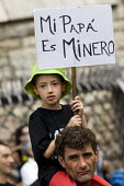Father and son march in Leon during the General Strike. The miners have been on strike since the government announced cuts to mining subsidies due to austerity cuts which will mean an end to mining. A... - Jess Hurd - 19-06-2012
