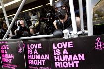 Amnesty International placards. World Pride 2012, London. - Jess Hurd - 07-07-2012