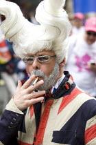 World Pride 2012, London. - Jess Hurd - 2010s,2012,addiction,British,CIGARETTE,cigarettes,equal,flag,FLAGS,gay,gays,gender,homosexual,HOMOSEXUALITY,homosexuals,LGBT,male,man,men,MINORITIES,MINORITY,nationalist,NATIONALISTS,nicotine,people,p