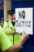 Protest outside New Scotland Yard after the news that PC Harwood had been cleared of manslaughter for the death of newspaper vendor Ian Tomlinson at the G20, London. - Jess Hurd - &,2010s,2012,activist,activists,CAMPAIGN,campaigner,campaigners,CAMPAIGNING,CAMPAIGNS,CLJ,Crime,death,DEATHS,DEMONSTRATING,Demonstration,DEMONSTRATIONS,died,Justice,Law,mortality,news,newspaper,NEWSPA
