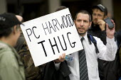 Man holds up a mobile phone, on a protest outside New Scotland Yard after the news that PC Harwood had been cleared of manslaughter for the death of newspaper vendor Ian Tomlinson at the G20, London. - Jess Hurd - &,2010s,2012,activist,activists,CAMPAIGN,campaigner,campaigners,CAMPAIGNING,CAMPAIGNS,CLJ,communicating,communication,Crime,death,DEATHS,DEMONSTRATING,Demonstration,DEMONSTRATIONS,died,Justice,Law,mor