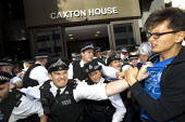 Disabled protesters clash with police as DPAC and UK Uncut occupy the Department of Work and Pensions DWP against the cuts to disabled benefits through the Paralympic sponsor Atos. London. - Jess Hurd - 31-08-2012