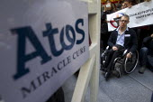 Disabled protesters from DPAC and UK Uncut against the cuts to disabled benefits through the Paralympic sponsor Atos, outside Atos HQ, London. - Jess Hurd - 31-08-2012