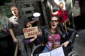Disabled protesters clash with police as DPAC and UK Uncut occupy the Department of Work and Pensions DWP against the cuts to disabled benefits through the Paralympic sponsor Atos, London. - Jess Hurd - 31-08-2012