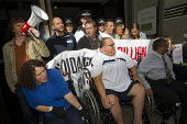 Disabled protesters clash with police as DPAC and UK Uncut occupy the Department of Work and Pensions DWP against the cuts to disabled benefits through the Paralympic sponsor Atos, London. - Jess Hurd - 2010s,2012,activist,activist activists,activists,adult,adults,against,anti,ATOS,austerity cuts,BENEFIT,benefit benefits,Benefit cuts,benefits,CAMPAIGN,campaign campaigning,campaigner,campaigners,CAMPA