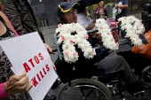 Disabled protesters lay a coffin outside Atos HQ to represent the people who have committed suicide after having their benefits cut. RIP. Opening day of the Paralympics. Euston, London. - Jess Hurd - 29-08-2012