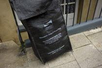 Reusable seagull proof bag, Thanet Council, Ramsgate, Kent. - Jess Hurd - 2000s,2007,bag,bags,bin bag,bin bags,binbag,binbags,bins,black,Council,Council Services,Council Services,local authority,pavement,plastic,public services,Ramsgate,REFUSE,Refuse Collection,rubbish,scen