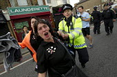 EDL member tries to throw a punch at photographer. A planned march and rally by the English Defence League is stopped by thousands of local anti-fascist protesters We Are Waltham Forest, who blocked t... - Jess Hurd - 01-09-2012