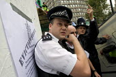 The Peoples Bailiffs attempt to evict Eric Pickles MP, Communities and local government secretary, on a mass action to mark the anniversary of the Dale Farm traveller site eviction. London. - Jess Hurd - 2010s,2012,activist,activists,adult,adults,anniversary,BAME,BAMEs,BME,bmes,CAMPAIGN,campaigner,campaigners,CAMPAIGNING,CAMPAIGNS,CLJ,DCLG,DEMONSTRATING,Demonstration,DEMONSTRATIONS,diversity,ethnic,et
