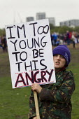 I'm too young to be angry. A Future That Works. March and rally organised by the TUC to protest against the government austerity policies and to call for an alternative economic strategy that puts job... - Jess Hurd - Protest,2010s,2012,activist,activists,adolescence,adolescent,adolescents,against,anti,austerity,Austerity Cuts,boy,boys,CAMPAIGNING,CAMPAIGNS,child,CHILDHOOD,children,DEMONSTRATING,demonstration,gover