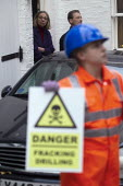 Gas Activists at the Chelsea Home of UK's Fracking Lord erect a symbolic fracking rig outside the home of Lord Browne. At 8am activists dressed in orange boiler suits and wearing gas masks erected a 2... - Jess Hurd - 01-12-2012