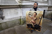 Political, satirical artist and painter Kaya Mar outside Downing Street with a new painting of George Osborne, left naked holding the steering wheel of a car crash, for the Chancellors Autumn budget s... - Jess Hurd - 05-12-2012