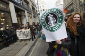 Tax avoidance campaigners, UK Uncut occupy a Starbucks cafe off Regents Street. Organisers highlight the government cuts to women and transform Starbucks stores across the country into refuges, creche... - Jess Hurd - 08-12-2012