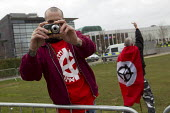 Far right extremists intimidate and take photographs of photographers. Far right extremists celebrating Worldwide White Pride Day, Swansea, Wales. - Jess Hurd - 09-03-2013
