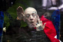 Far right extremist Nazi sieg heil salute from a coach window. Worldwide White Pride Day, Swansea, Wales. - Jess Hurd - 09-03-2013