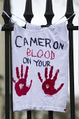 Cameron Blood on your Hands. Protest against the Bedroom Tax and welfare cuts to social housing and benefits. March to Downing Street. London. - Jess Hurd - 2010s,2013,activist,activists,against,anti,austerity cuts,Bedroom,BEDROOMS,Benefit cuts,Blood,CAMPAIGN,campaigner,campaigners,CAMPAIGNING,CAMPAIGNS,clothing clothes,cuts,DEMONSTRATING,DEMONSTRATION,DE