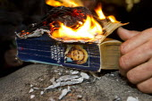 Protesters burn the book, Margaret Thatcher - The Downing Street Years. Party in Trafalgar Square to celebrate the death of former British Prime Minister Margaret Thatcher. London. - Jess Hurd - 13-04-2013