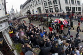 Protesters gather and turn their backs on the military funeral procession as a Union flag-draped coffin of former British Prime Minister Margaret Thatcher passes Ludgate Circus to St Paul's Catherdral... - Jess Hurd - 17-04-2013
